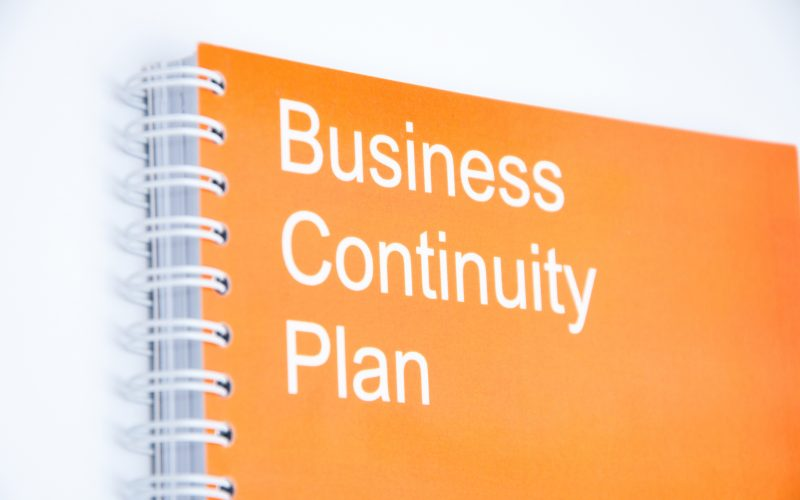 "Small notebook with inscription ""Business continuity plan"""